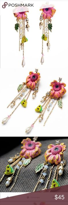 Fluttering Rose Earrings. Fluttering Rose Earrings - Boasting beauty in the form of colored flowers, these ear crawlers offer ethereal style whether worn day or night! Jewelry Earrings