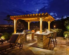 A grilling station creates an inviting spot for family and friends to gather outside. The pergola offers some coverage and defines the outdoor kitchen area.