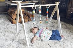 Learn how to make a wooden baby gym with this helpful step by step guide Wood Baby Gym, Diy Baby Gym, Wooden Baby Toys, Wood Toys, Play Gym, Diy Headboards, Baby Furniture, Furniture Ideas, Baby Play