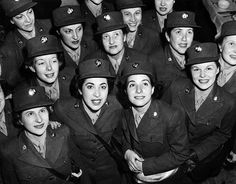 Hundreds of women from the Women's Army Corps (WAC), arrive in New York, October 16, 1942 ~
