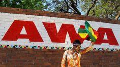 AWA waving a Zimbabwe flag