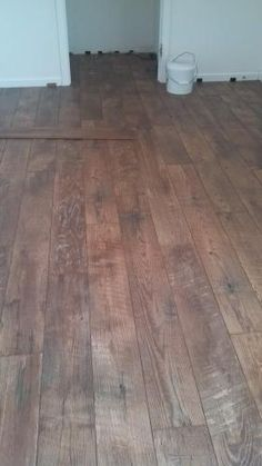 hampton bay country oak dusk 12 mm thick x 6-3/16 in. wide x 50- 1