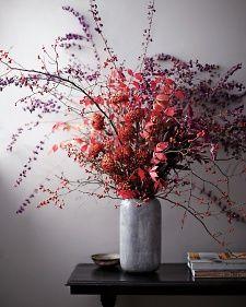 Martha Stewart Home & Garden; Chrysanthemum Arrangement-- nestled in winterberry, burning bush and purple beauty-berry.   Dramatic/Unexpected  Wonderful for a fall wedding