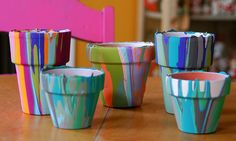 Drip paint pots: Flip the pot upside-down and continue to drip different colors of paint on the bottom of the pot.  The colors will eventually pool and force each other to drip down the sides of the pot, making this awesome creation!