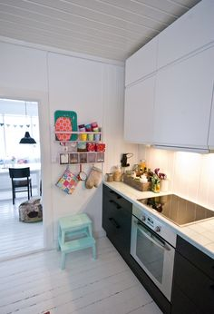 Contrasting a black kitchen with a white floor makes a space appear bigger than it actually is.