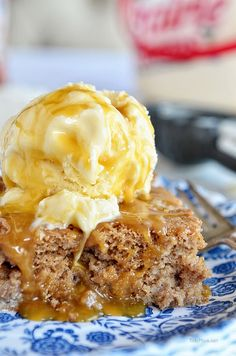 Cinnamon Roll Poke Cake is dangerously easy and tastes just like the gooey center of a cinnamon roll! This recipe starts with a spice cake mix and can of soda,comined with sweetened condensed milk, topped with vanilla ice cream and caramel sauce and you end up with the most delectable cake that ever lived! mouth watering recipe at TidyMom.net