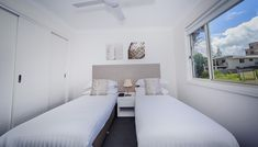 Executive Townhouses | Family Friendly Accommodation - Escape At Nobby's Washing Machine In Kitchen, Iphone Docking Station, Electric Bbq, Holiday Accommodation, Two Bedroom, Queen Beds, Open Plan, Living Area, Townhouse