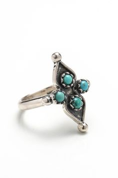 Delicately hand crafted ring in .925 silver, designed while dreaming of a jasmin filled court yard in some forgotten Moroccan palace. Made with petite turquoise stones that vary in shades of green and blue, the ring adds that subtle bohemian touch to every outfit.   Details Measurements Delivery & Returns   .925 Sterling Silver Turquoise Stones   Ring Height - 2.5cm Ring Width - 1.5cm   FREEWORLDWIDE SHIPPING We want you to be completely satisfied with your online purchase. If you are ...