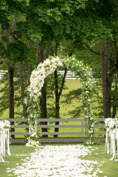 Alfresco Ceremony on Farm, Floral Arch   Photo: Images by Berit, Inc. View More:  http://www.insideweddings.com/weddings/tented-backyard-wedding-with-equestrian-details-at-a-family-farm/931/