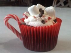 Chocolate Chip Cupcakes with Whipped buttercream frosting.  Topped with marshmallows, crushed candy cane, and mini chocolate chips. The handle is a small candycane.    Thank You CC for the inspiration!!!!