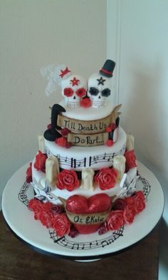 Double sided skull wedding cake by www.facebook.com / petticoatsandfrillscakes