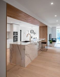 Modern home with kitchen, quartzite counter, white cabinet, light hardwood floor, ceiling lighting, subway tile backsplashe, recessed lighting, undermount sink, and wall oven. Photo 3 of Richview Residence