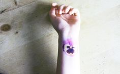 Pansy Tattoo  Design III by clowders on Etsy, £4.50... Different spot though, maybe below the ear? And add yellow to the center :)