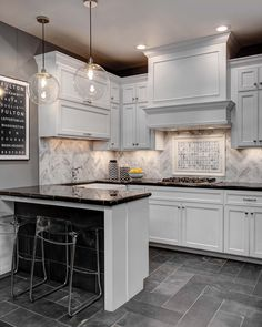 Bring distinctive style to your kitchen backsplash design with this white marble tile featuring a tumbled surface with subtle grey speckling and grey and tan veining - Hampton Carrara Tumbled Large Herringbone Marble Mosaic Tile https://www.tileshop.com/product/650000-P.do