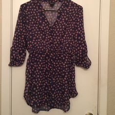 Navy blue rose pattern flowy top. Rue 21 navy with rose pattern print. Medium brand new without tags, Has a gorgeous flow and it grips you're body so pretty. The sleeves are buttoned up to be 3/4 length Rue 21 Tops Blouses
