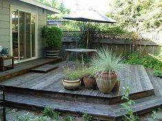 A Deck made from old barnwood,  great idea.