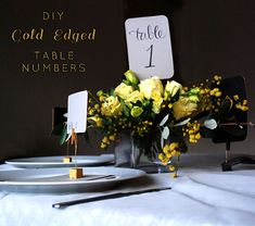 """DIY Gold-Edged Wedding Table Numbers on bloglovin"" maybe not exactly this, but something simple as a part of your centerpiece?"