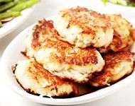 "Latkes  4 lg potatoes   1 onion   1 egg, beaten   2 tbl Flour, Matzo or corn meal   salt  2 tbl oil or enough to fill the pan to about 1/4 inch  applesauce and/or sour cream   Peel & grate potatoes & onion.   Soak the mixture in water, or squeeze it in a dishtowel to remove excess starch.   Mix potato & onion with egg, meal, and salt.   Heat oil in a 10"" pan over medium heat until it is quite hot. Drop 1-2 tablespoons of the potato mixture onto the pan per pancake. Turn once."
