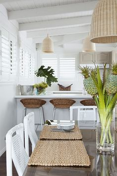 Tropical, bright white, and natural elements......perfect.