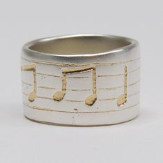 Silver ring with customers own musical notes etched in 22ct yellow gold