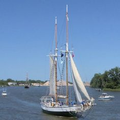 Madeline - Parade of Sails - This is a view of Madeline with Unicorn in the distance (to the left) moving up the Saginaw River toward Bay City, Bay County, Michigan, US. This was the Parade of Sails (July 11, 2013), the official entrance of the tall ship fleet to start the Tall Ship® Celebration, part of the Tall Ships Challenge® Great Lakes 2013. This photograph was taken from the western approach of a railroad bridge just down river from Liberty Bridge near downtown Bay City.