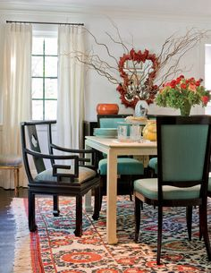 teal dining room chairs with orange accents and both dark and light wood