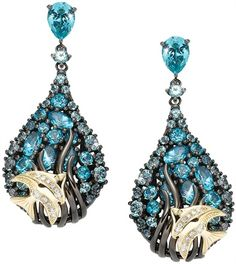 Gemtique  Earrings in gold, silver and Swarovski Gems.