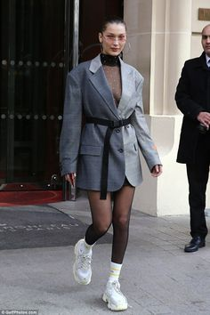 Not so hot: Bella Hadid appeared to forgo her usually chic sense of style, as she stepped out for a low-key outing in Paris sporting a rather unusual combination when it came to her footwear on Wednesday