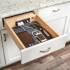 This is sooooo handy! Keep all your wires tucked in and devices away...WOOALA to a clean  countertop!