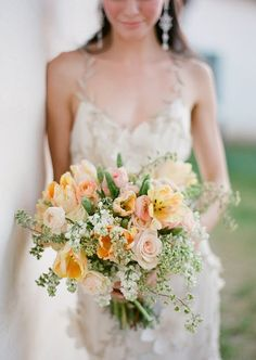 Love the soft, romantic but yet loose look of this peach bouquet