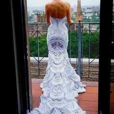 The pattern work on this wedding/evening gown is stunning! The details on the train is unbelievable
