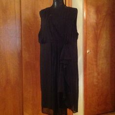 Black Sleeveless Dress Plain black dress. Does not have a size but I think it would fit size 20. Dresses