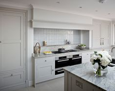 Surrey country kitchen double oven with chimney hood and bespoke kitchen cabinets hand painted in 'Lead V' by Paint & Paper Library.