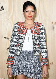 Freida Pinto in a signature Isabel Marant patterned jacket and short ruffled skirt with a white top.