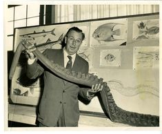 Walt Disney holds up a tentacle belonging to the Submarine Voyage octopus.