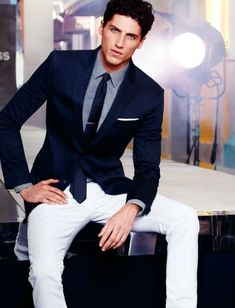 Shop this look for $166:  http://lookastic.com/men/looks/blazer-and-tie-and-jeans-and-dress-shirt-and-pocket-square/1714  — Navy Blazer  — Navy Silk Tie  — White Jeans  — Light Blue Dress Shirt  — White Pocket Square