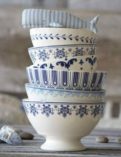 blue and white. I don't love the patterns, but I love the silhouette of the pedestal bowl.