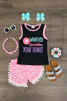 """Have your princess the star of the show in this adorable """"Whatever Sprinkles Your Donut"""" pom pom short set! Pom Pom's are all the rage right now! This look is so in! Made with soft cotton fabric, super comfy, while still being so stylish! Perfect for Spring and Summer! Set Includes: Tank and pom pom shorts."""