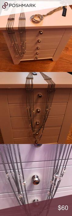 2 piece Ann Taylor necklace bundle Gold ring pendant retails for 48. Silver gem chandelier necklace retails for 58. Comes with Ann Taylor dust bag. Ann Taylor Jewelry Necklaces