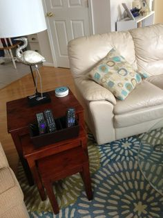 I had these pillows first and found a rug to match later at Home Goods. A good combo! I wanted something a little on the wild side for a rug. The side stack table came from Marshalls. The remote caddy too!