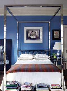 A vintage chrome four-poster is the centerpiece of this traditional Manhattan bedroom.