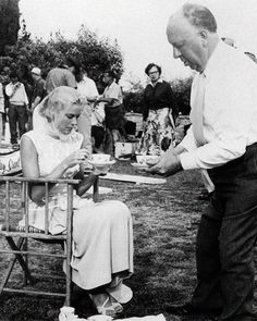 Alfred Hitchcock having tea with Grace Kelly behind the scenes of To Catch a Thief (1955)