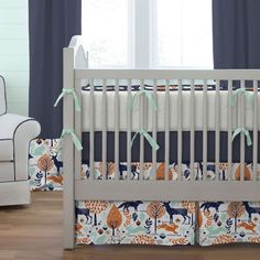 Navy and Orange Woodland Crib Bedding by Carousel Designs.  Nature surrounds you with this adorable woodland scene fabric. From frolicking deer to sly foxes and playful bunnies your favorite is sure to be among them. Featured in rich Windsor navy and deep orange and printed on a soft 100% cotton its perfect for your special nursery.