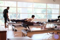 In between client sessions, Karen practices the Pulling Straps movement on the #Pilates Reformer Longbox.