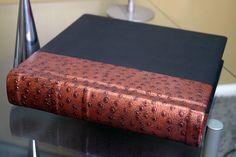 "Amazing wedding album by Finao Albums www.finao.com ""Bank Heist"" and ""Miami Ink"" leather.  # wedding album senior portrait boudoir baby book photography photographer black copper bronze penny ostrich"