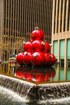 1. Gigantic Christmas decorations and lights in midtown Manhattan Giant red ornaments at 1251 Sixth Avenue, near Rockefeller Plaza. If you let your imagination run wild, these Christmas ornaments will remind you of huge caramelized apples or gigantic pomegranates, quite appropriately for the season!