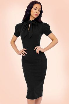 Go for the sexy secretary look in this50s Bonnie Tie Neck Pencil Dress!  Super sexy without showing skin ;-) The playful short puffed sleeves, little collar with tie straps and subtle keyhole are gorgeous but the real eyecatchers are your curves that will be perfectly emphasized by Bonnie, oh la la. Made from a lovely supple and flattering, stretchy black fabric for a curvalicious fit. Who said goody-goody can't be sexy?!   Short puffed sleeves Fixed tie straps Keyhole at the fro...