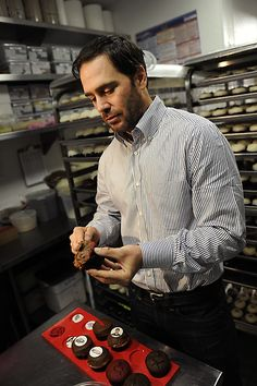 Daytona 500 champion Jimmie Johnson puts icing on cupcakes at Sprinkles Cupcakes at The Grove, Wednesday, February 27, 2013. (Michael Owen Baker/Staff Photographer)