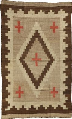 A NAVAJO REGIONAL RUG c. 1920 woven of native handspun wool in natural ivory and brown, and aniline red, with a - Available at 2009 January American Indian. Native American Rugs, Native American Artifacts, American Indian Art, Navajo Weaving, Navajo Rugs, Weaving Art, Indian Quilt, Indian Rugs, Spirited Art