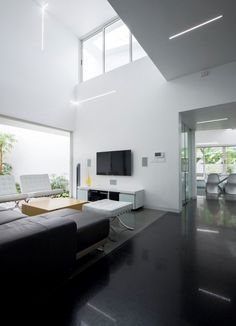 Once inside, simplicity takes over. Although elegant details like vaulted ceilings and sumptuous furniture create a space to be reckoned with, the a calming white palette and low, clean lines are ultimately easy to experience. This minimalism is not necessarily what you might expect from the way in which the exterior seems to shout.